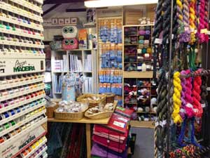 Showroom with knitting yarn, quilting fabric, sewing thread, buttons, knitting needles
